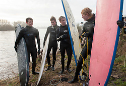 © Licensed to London News Pictures.  20/02/2015. Gloucestershire, UK.  Surfers from Bristol Surf Club ride the Severn Bore on a misty morning at Newnham and Minsterworth.  The alignment of the sun and moon creating high tides led to a prediction for the biggest wave for 19 years.  Photo credit : Simon Chapman/LNP