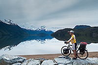 Cyclist admiering the landdscape in the very southern most end of Carretera Austral, Chile