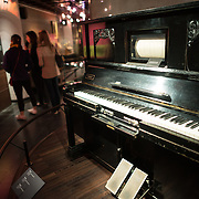 A pianolo built in 1900 on display a the Musical Instrument Museum in Brussels. The Musee des Instruments de Musique (Musical Instrument Museum) in Brussels contains exhibits containing more than 2000 musical instruments. Displays include historical, exotic, and traditional cultural instruments from around the world. Visitors to the museum are given handheld audio guides that play musical demonstrations of many of the instruments. The museum is housed in the distinctive Old England Building.