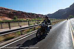 Jeff Tiernan riding his 1929 Henderson KJ on Utah Highway 128 north of Moab during stage 11 (289 miles) of the Motorcycle Cannonball Cross-Country Endurance Run, which on this day ran from Grand Junction, CO to Springville, UT., USA. Tuesday, September 16, 2014.  Photography ©2014 Michael Lichter.