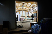 Marta Bania (left) and Robert Zmuda play ping pong in the storage warehouse at the Polish Polar Station in Hornsund, Svalbard.