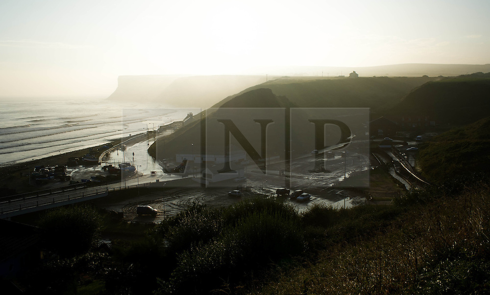 © Licensed to London News Pictures. 07/09/2013<br /> <br /> Saltburn, Cleveland, England<br /> <br /> Looking down at a mud filled car park following an evening of torrential rainfall that caused flooding and disruption to Saltburn in Cleveland.<br /> <br /> Photo credit : Ian Forsyth/LNP