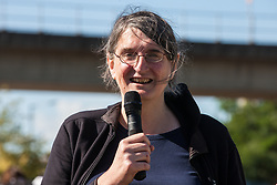 London, UK. 2 September, 2019. Kirsten Bayes of Campaign Against the Arms Trade (CAAT) addresses activists outside ExCel London on the first day of week-long protests against DSEI 2019, the world's largest arms fair.