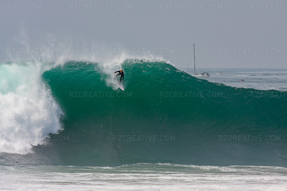 A surfer drops into a large wave at The Wedge in Newport Beach. Photo © Robert Zaleski / rzcreative.com<br /> —<br /> To license this image contact: robert@rzcreative.com