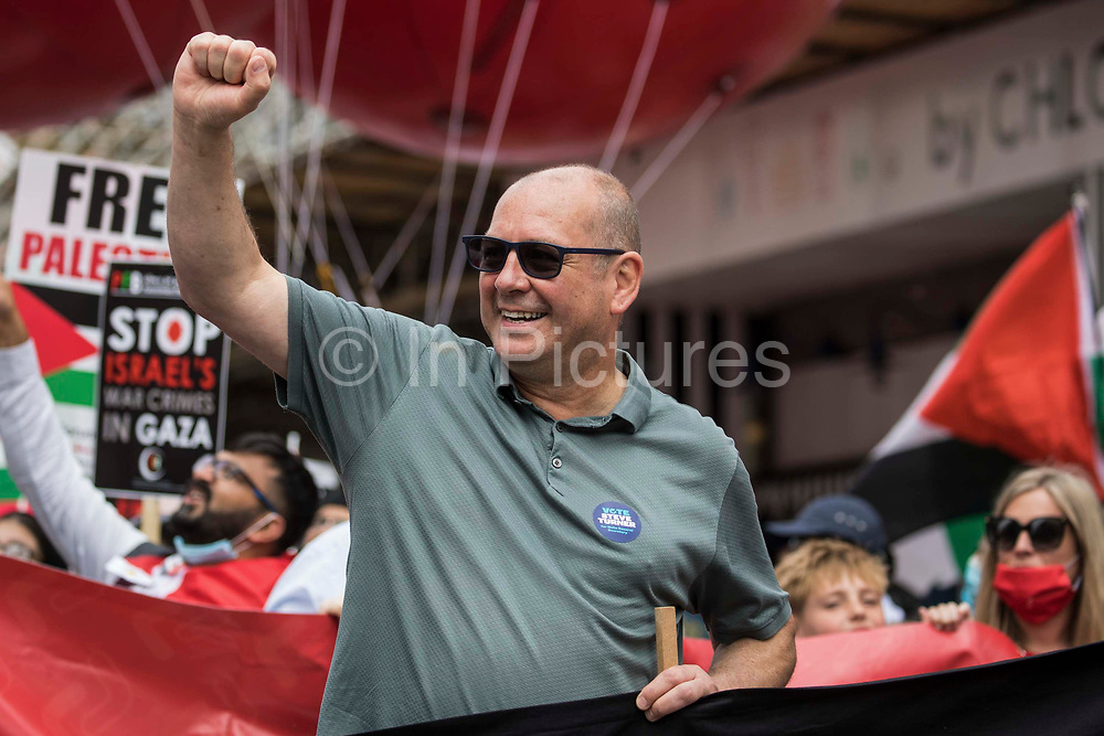 Steve Turner, candidate to become general secretary of Unite the Union, raises his fist as he joins thousands of people attending a United Against The Tories national demonstration organised by the Peoples Assembly Against Austerity in protest against the policies of Prime Minister Boris Johnsons Conservative government on 26th June 2021 in London, United Kingdom. The demonstration contained blocs from organisations and groups including Palestine Solidarity Campaign, Stand Up To Racism, Stop The War Coalition, Extinction Rebellion, Kill The Bill and Black Lives Matter as well as from trade unions Unite and the CWU.