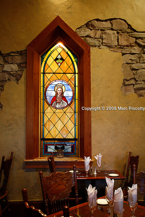 SHOT 10/16/08 4:19:13 PM - The Old Stone Church Restaurant in Castle Rock, Co. Originally the St. Francis of Assisi Church built in 1888 the building served as a working church until 1966 when the congregation moved to a larger church east of town. In 1975 the building was decommissioned and underwent remodeling to become a restaurant currently serving a Southwestern influenced menu. A view of the dining room and some of the original stained glass windows..(Photo by Marc Piscotty / © 2008)