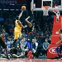 30 November 2017: Utah Jazz center Ekpe Udoh (33) goes for the layup over LA Clippers center Willie Reed (35) during the Utah Jazz 126-107 victory over the LA Clippers, at the Staples Center, Los Angeles, California, USA.