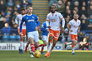 Portsmouth Midfielder, Adam May (30) and Blackpool Forward, Nathan Delfouneso (30) during the EFL Sky Bet League 1 match between Portsmouth and Blackpool at Fratton Park, Portsmouth, England on 24 February 2018. Picture by Adam Rivers.