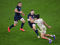 Rugby Union - 2020 Autumn Nations Cup - England vs Georgia - Twickenham<br /> <br /> England's Elliot Daly evades the tackle of Georgia's Giorgi Kveseladze.<br /> <br /> COLORSPORT/ASHLEY WESTERN