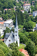 Bled church as seen from Bled Castle is a medieval castle built on a precipice above the city of Bled in Slovenia, overlooking Lake Bled.