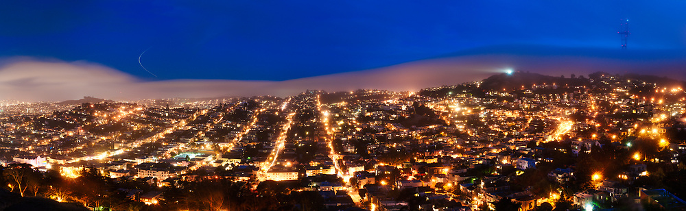 The Castro, Noe Valley, Twin Peaks and Sutro tower are seen in this dusk panorama from Corona Heights. San Francisco, California.