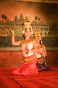 Beautiful Apsara dancers perform at Jasmine restaurant in Siem Reap. The ancient artform of Apsara dance is loaded with the symbolism of each move or position the dancers perform. Basic dance training takes 6 years with a further 5 or 6 years to mature artistically, learning some 1500 positions in total. The dancers are sewn into their silk tunics before each performance to ensure a tight fit. During the rein of Jayavarman VII, 3000 dancers performed exclusively for the king.