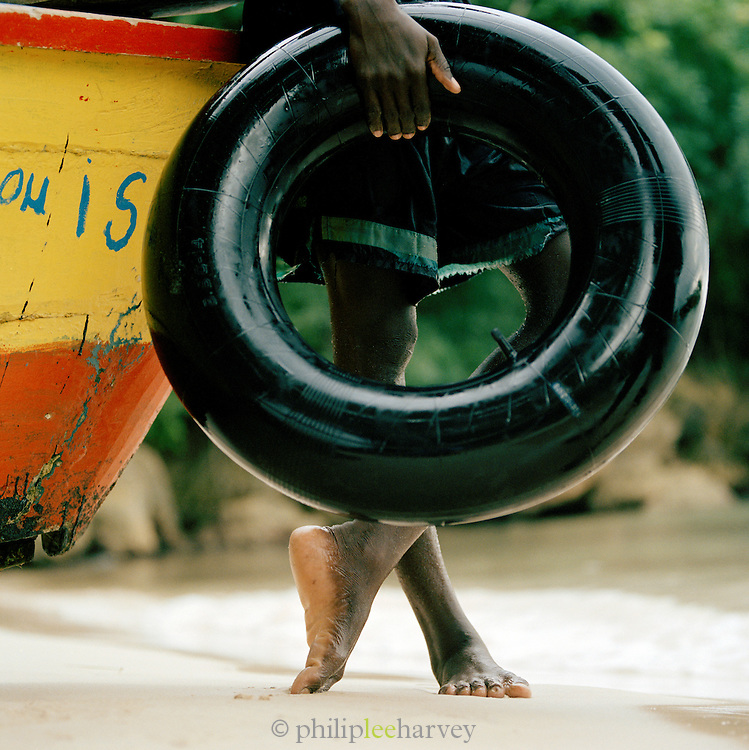 Man holding a rubber ring at a beach near Port-Au-Prince, Haiti