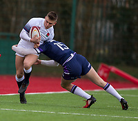 England's Ollie Sleightholme is tackled by Scotland's Charlie Hudson<br /> <br /> Photographer Bob Bradford/CameraSport<br /> <br /> The 2018 U18 6 Nations Festival - Scotland U18 v England U18 - Saturday 31st March 2018 - CCB Centre for Sporting Excellence, Ystrad Mynach Hengoed <br /> <br /> World Copyright © 2018 CameraSport. All rights reserved. 43 Linden Ave. Countesthorpe. Leicester. England. LE8 5PG - Tel: +44 (0) 116 277 4147 - admin@camerasport.com - www.camerasport.com