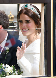 Princess Eugenie in the Scottish State Coach during the carriage procession following their wedding at St George's Chapel, Windsor Castle. Photo credit should read: Doug Peters/EMPICS