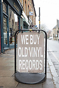 We Buy Old Vinyl Records sign outside Flashback record shop on the 27th March 2018 in Crouch End, North London in the United Kingdom.