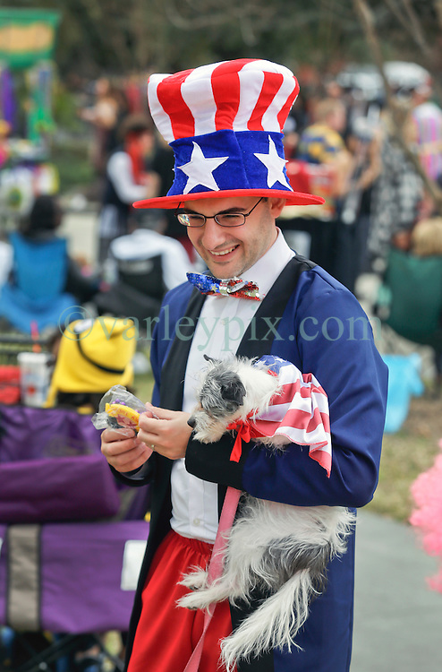 31 January 2016. New Orleans, Louisiana.<br /> Mardi Gras Dog Parade. Andy Wilcox with dog Smoggy. The Mystic Krewe of Barkus winds its way around the French Quarter with dogs and their owners dressed up for this year's theme, 'From the Doghouse to the Whitehouse.' <br /> Photo©; Charlie Varley/varleypix.com