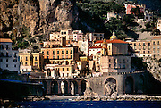 A few passing clouds cast shadows on a beautiful view of the Amalfi Coast of Italy