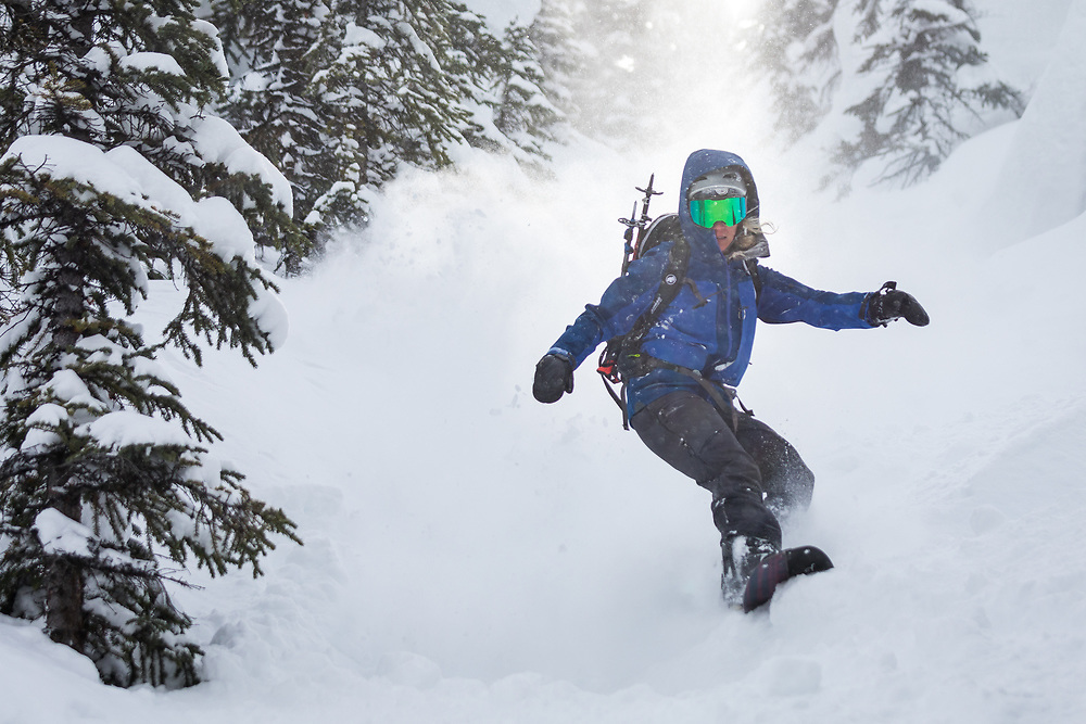 Mindy Lamoureux Skiing pow at Crowfoot Glades along the Icefields Parkway in Alberta, Canada