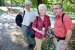 Group of older people looking at a park location map and planning their walk; Nottingham,