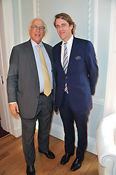 Left to right, SIR EVELYN DE ROTHSCHILD and BEN ELLIOT  at a party to celebrate the 60th birthday of Mark Shand and the 50th birthday of Tara the elephant held at 29 Portland Place, London on 25th May 2011.