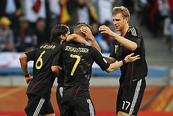 03.07.2010, CAPE TOWN, SOUTH AFRICA, im Bild .Sami Khedira, Miroslav Klose and Per Mertesacker of Germany congratulate Bastian Schweinsteiger of Germany on scoring during the Quarter Final, Match 59 of the 2010 FIFA World Cup, Argentina vs Germany held at the Cape Town Stadium..Foto ©  nph /  Kokenge