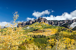Timmeron Ridge of the San Juan Mountains bathed in the festive color of autumn.  Timmeron Ridge is just east of Ridgeway Colorado