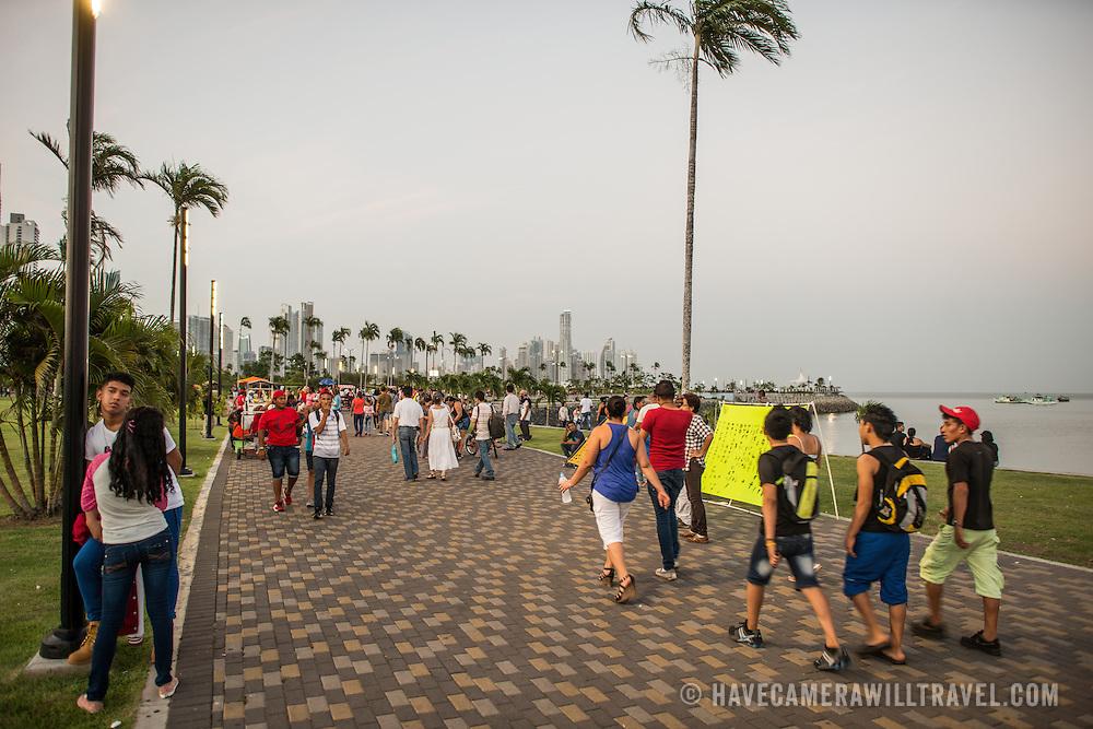 People enjoying an evening stroll on the  waterfront boardwalk in Casco Viejo in Panama City, Panama.