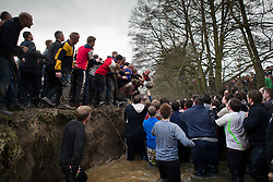 © London News Pictures. 05/03/2014. Ashbourne, UK. . DAY TWO as  the Up'Ards and the Down'Ards, fight for the ball during the second day of the Royal Shrovetide Football match in Ashbourne, Derbyshire. For two days, over Shrove Tuesday and Ash Wednesday, hundreds of participants battle it out in a 'no rules' game dating back to the 17th Century where the aim is to get a ball into one of two goals that are positioned three miles apart at either end of Ashboune. Photo credit: Ben Cawthra/LNP