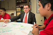 Houston ISD superintendent Dr. Terry Grier, center, talks with students during a Broad Foundation research team tour Ortiz Middle School, May 29, 2013.