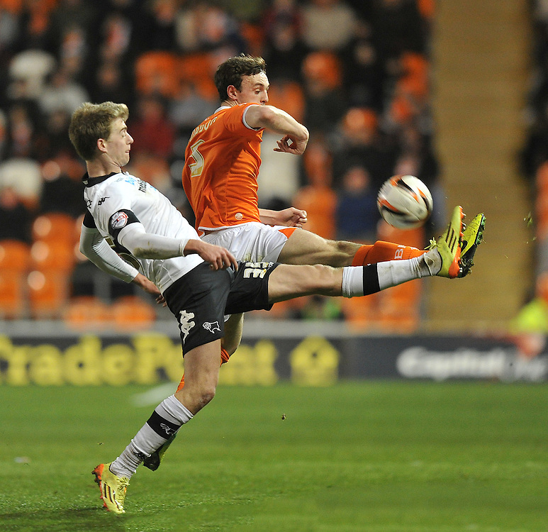 Blackpool's Jack Robinson and Derby County's Patrick Bamford battle for the ball <br /> <br /> Photo by Dave Howarth/CameraSport<br /> <br /> Football - The Football League Sky Bet Championship - Blackpool v Derby County - Tuesday 8th April 2014 - Bloomfield Road - Blackpool<br /> <br /> © CameraSport - 43 Linden Ave. Countesthorpe. Leicester. England. LE8 5PG - Tel: +44 (0) 116 277 4147 - admin@camerasport.com - www.camerasport.com