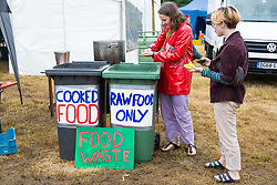 Roydon, Essex, UK. 27 July, 2019. Food waste is collected at Reclaim The Power's Power Beyond Borders mass action camp.