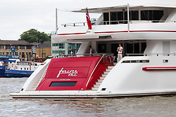 "© Licensed to London News Pictures. 16/06/2018. London, UK.  Bruce Grossman's 180 feet long superyacht, Forever One sails on the River Thames in London after passing under Tower Bridge. Bruce Grossman is one of the richest men in Mexico (estimated net worth of USD1.5 billion) and shareholder of Arca Continental, the second largest Coca-Cola bottler in Latin America and third largest in the world. The unusual red colour scheme of the yacht reflects Grossman's significant Coca-Cola business interests and the yacht also features a reverse bow, fold-down balconies and a beach club with large window in the transom. The name Forever One refers to Bruce's wife Elsa, the childhood best friend of his younger sister and who later became Grossman's ""forever one""..  Photo credit: Vickie Flores/LNP"