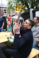 Love at first sight as fans celebrate with the Premier League Trophy outside the stadium and through the city before and during the Premier League match between Liverpool and Aston Villa at Anfield, Liverpool, England on 5 July 2020.