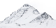 A wide print of snow-covered peak along the Southern Alps, South Island, New Zealand