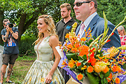 Katherine Jenkins leaves escorted by security, flowers and media after singing on the Waterfront stage in front of a large crowd - The 2017 Latitude Festival, Henham Park. Suffolk 16 July 2017