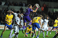 Arsenal keeper Wojciech Szczesny claims the ball from a Swansea corner. Barclays Premier league, Swansea city v Arsenal at the Liberty Stadium in Swansea on Saturday 28th Sept 2013.  pic by Andrew Orchard, Andrew Orchard sports photography.