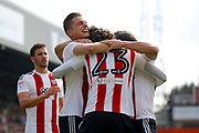 Brentford players celebrate a goal from the spot from Brentford midfielder Jota (23) (score 2-0) during the EFL Sky Bet Championship match between Brentford and Queens Park Rangers at Griffin Park, London, England on 22 April 2017. Photo by Andy Walter.