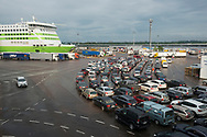 Tallinn, Estonia - July 8, 2015: Lines of vehicles wait to board the MS Star in the port of Tallinn, Estonia. The Star was built in 2007 and has a capacity for 450 cars and 2080 passengers. The ferry is operated by the Estonian ferry company Tallink and connects the cities of Tallinn and Helsinki.