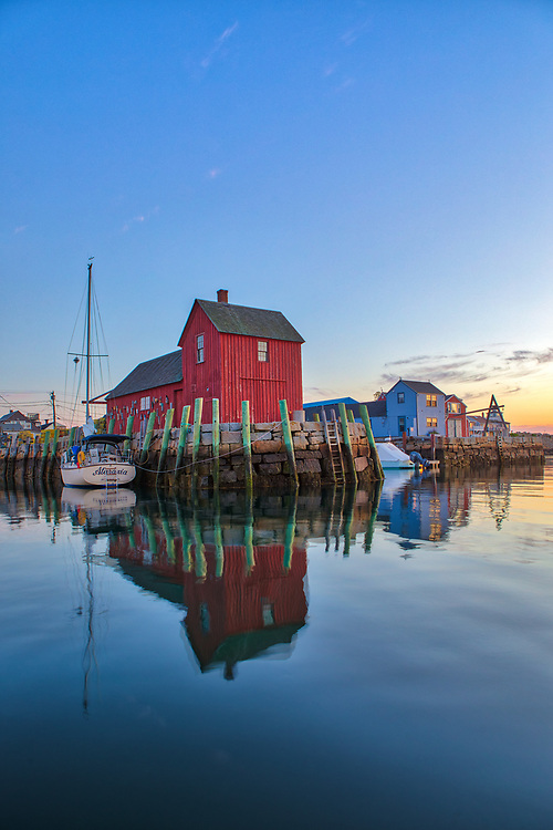 Massachusetts harbor scenery of Motif Number One and sail boat reflection during sunrise twilight and dawn at Rockport Harbor on Cape Ann, Massachusetts.<br /> <br /> Cape Ann Massachusetts harbor scenery photography image artworks are available as museum quality photography prints, canvas prints, acrylic prints, wood prints or metal prints. Prints may be framed and matted to the individual liking and decorating needs.<br /> <br /> Good light and happy photo making!<br /> <br /> My best,<br /> <br /> Juergen