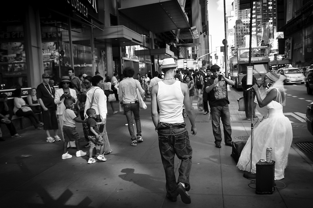Street photography of a singer in Times Square, Manhattan, NYC