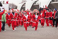 Dec. 22, 2019, Tokyo, Japan: This is the Tokyo Great Santa Run 2019, a charity event in its second year that raised money for sick children in Japan and Maasai communities in Kenya. Over 3000 Santa clad runners and walkers participated in this event which included a 4.3K Fun Run or 2K Fun Walk. Donations to enter cost between ¥1100 to ¥3300 ($10-$30) depending on age, which included a Santa costume. This year the event was held at Komazawa Olympic Park. Photo by Torin Boyd.