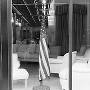 american flag in window of store sitting area
