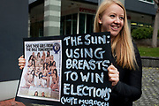 London, UK. Saturday 17th November 2012. Demonatrators outside the News International offices protest for No More Page Three, against nudity in the national press. Page three of The Sun still has a naked topless model every week day.