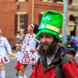 York, PA / USA - March 12, 2016: A bearded man wears a tall green hat at the annual Saint Patrick's Day Parade.