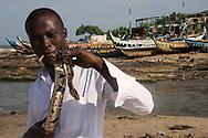 Man smoking a joint holding a pet snake