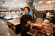 Chinese woman selling Feng Shui compass in gift shop of Shaanxi History Museum, Xian, China