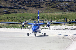 Barra airport, situated in the wide shallow bay of Traigh Mhòr at the north tip of the island of Barra in the Outer Hebrides, Scotland. The airport is unique, being the only one in the world where scheduled flights use a beach as the runway.