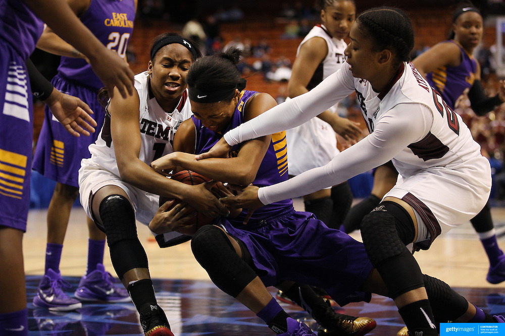Jada Payne, East Carolina and Erica Covile, (left), Temple, challnege for a loose ball during the Temple Vs East Carolina Quarterfinal Basketball game during the American Women's College Basketball Championships 2015 at Mohegan Sun Arena, Uncasville, Connecticut, USA. 7th March 2015. Photo Tim Clayton