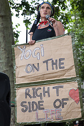 A speaker holds a sign highlighting the case of Yogi, a Stop HS2 and Palestine Action activist currently on hunger strike in prison, at a Kill The Bill protest in Parliament Square against the Police, Crime, Sentencing and Courts (PCSC) Bill 2021 as MPs consider amendments to the Bill in the House of Commons on 5th July 2021 in London, United Kingdom. The PCSC Bill would grant the police a range of new discretionary powers to shut down protests, including the ability to impose conditions on any protest deemed to be disruptive to the local community, wider stop and search powers and sentences of up to 10 years in prison for damaging memorials.